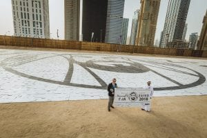 NA070718-NM-DMCC. Guinness World Record adjudicator, Kevin Southam presenting the certificate of Guinness World Record to Executive Chairman of DMCC, Ahmed bin Sulayem after DMCC made worldÕs largest jigsaw puzzle by surface area. Comprised of over 12,000 pieces, the completed jigsaw is a 6,000m2 (64,583 ft?), Year of Zayed logo displayed at Uptown construction site in Jebel Ali, Dubai. Photo by Neeraj Murali.